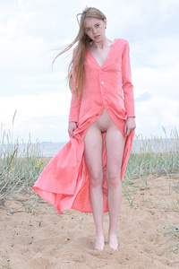 The beach is all nice and ready to see her sweet teen pussy shine bright in the sand as she is posing for you.