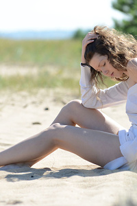 The beach and sunshine only adds to her stunning teen beauty and the way she slowly strips naked from her clothes.